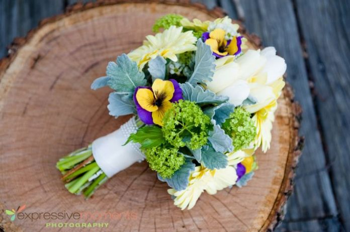 beautiful bright wedding bouquet with pansies