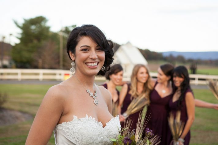 Bride with bridesmaids at a rustic country wedding