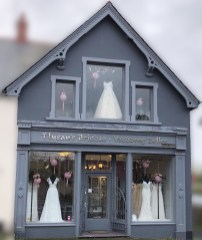 Pink lanterns and ribbons join our wedding dresses in the windows this week