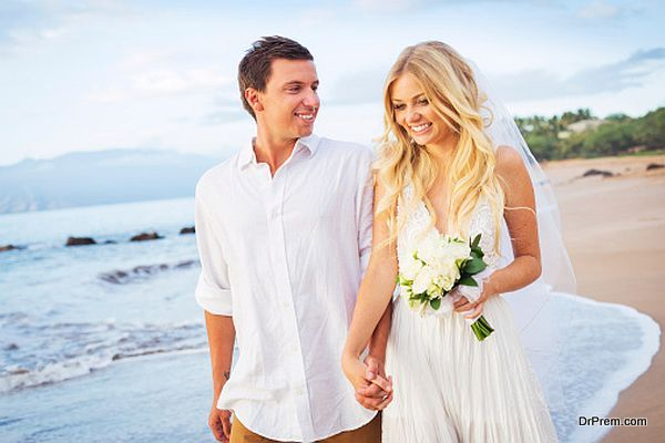 Bride and Groom Walking on Beautiful Tropical Beach at Sunset