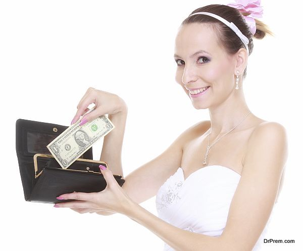 Marriage and money concept of high wedding cost. Bride with purse with one dollar isolated