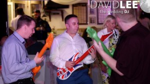 Inflatable guitars being played by wedding guests