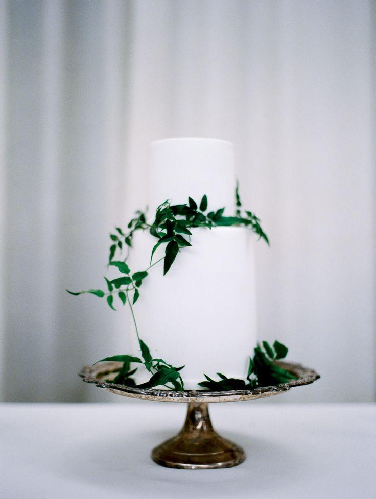 Wedding Cakes Elegant White Cake Adorned With Greenery