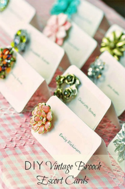 vintage brooch escort cards via intimate weddings