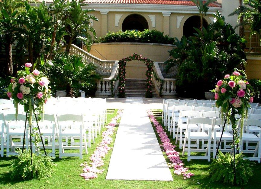 Wedding Flowers and Arch at Outdoor Garden Wedding at Ritz Carlton Sarasota