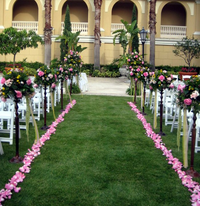 Wedding Flowers Decorate Aisle at Ritz Carlton Sarasota Wedding