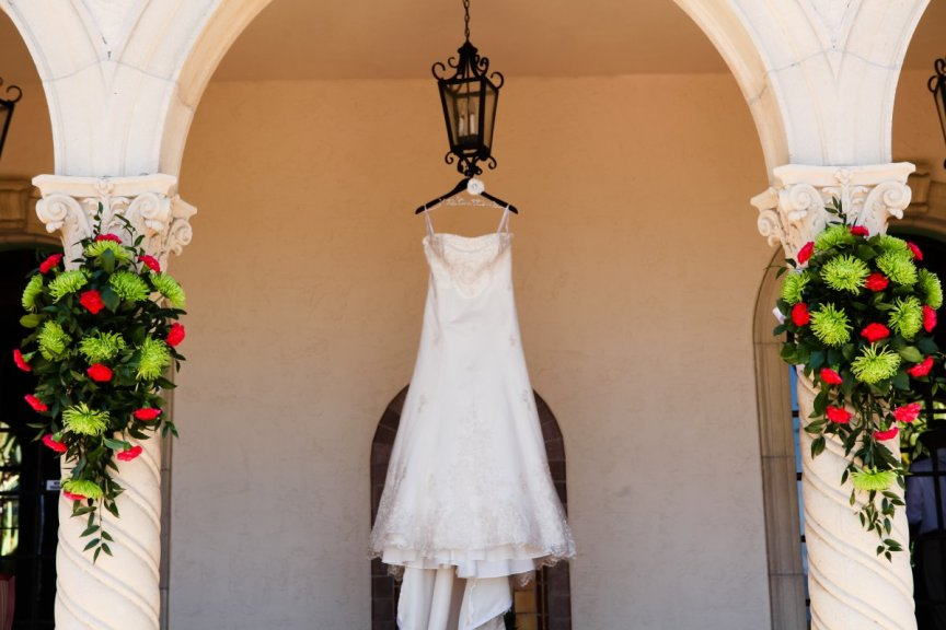 Wedding dress surrounded by flower arrangements at the Powel Crosley Estate