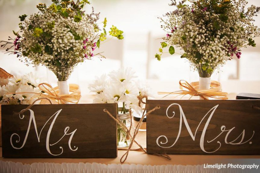Mrs. and Mrs. Signs with Wildflowers