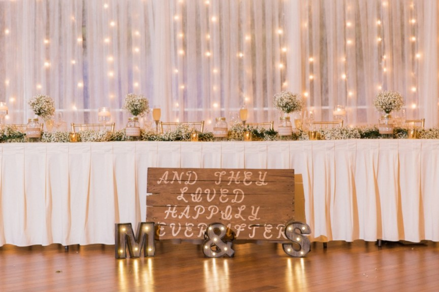 Head Table with Bridesmaids' Bouquet in Mason Jars