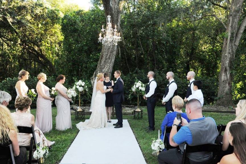 Ceremony Site with Flowers and Chandeliers