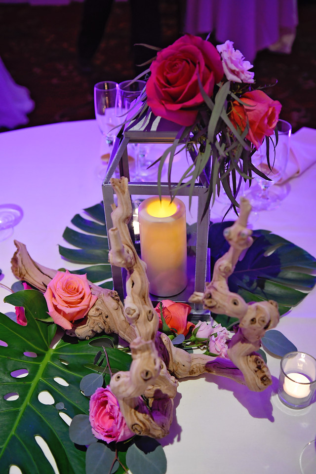 Table Centerpieces with Lanterns, Ghost Wood, and Flowers