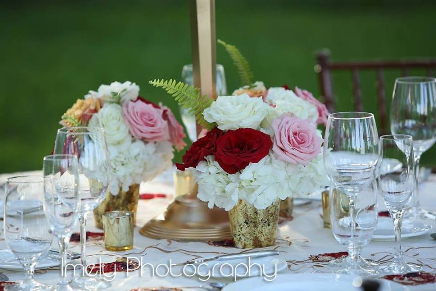 Smaller Flower Arrangements at Base of Candleabra for Guest Tables
