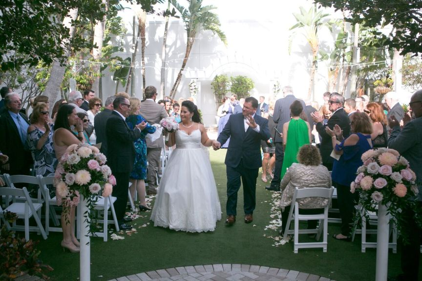 Bride and Groom Coming Down Aisle, Aisle Flowers