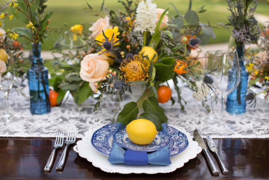 Close-up of Feasting Table Place Setting and Floral Vintage and Modern Centerpiece