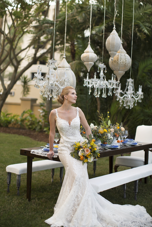 Bride with Bridal Bouquet in front of intimate feasting table