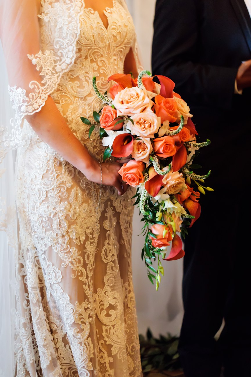 Cascading Bridal Bouquet with Mini Calla Lilies Coral Roses and Shimmer Garden Roses