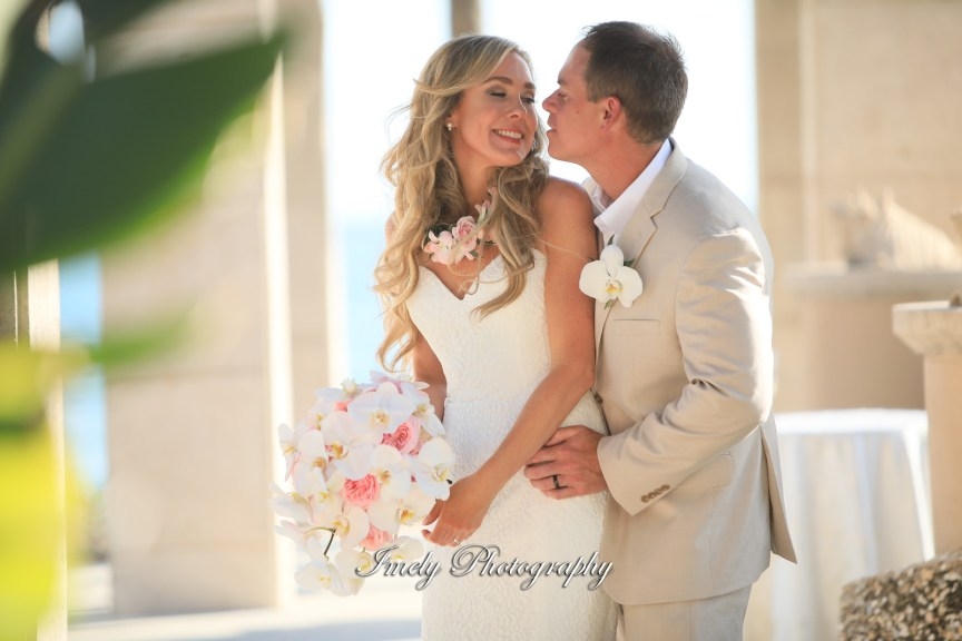 Bride with Roses and Phalaenopsis Bouquet and Groom with Orchid Boutonniere