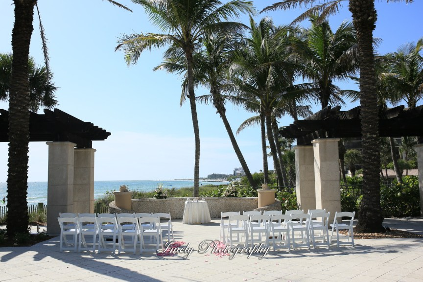 Ceremony Site with Pink Roses Petals Down Aisle and Small Floral Arrangements