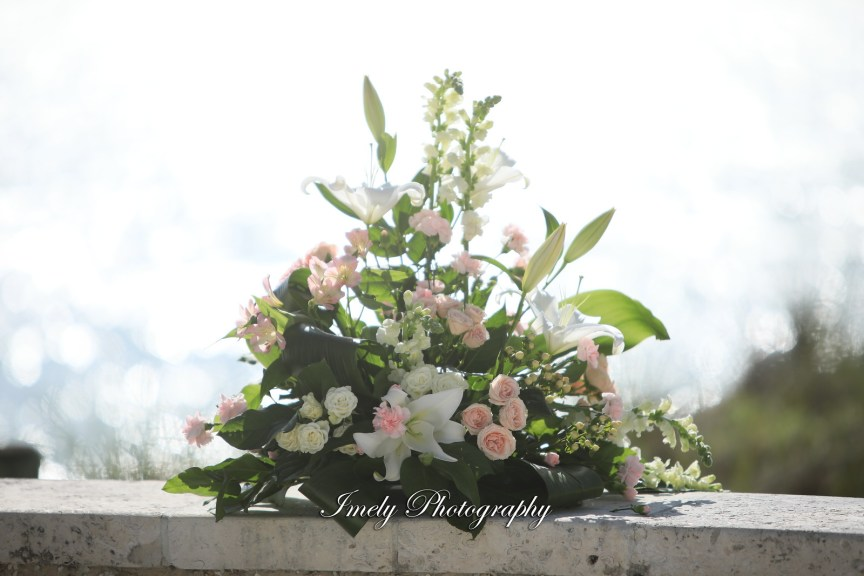 Pink and White Floral Arrangement for Ceremony Later Re-Purposed for Reception