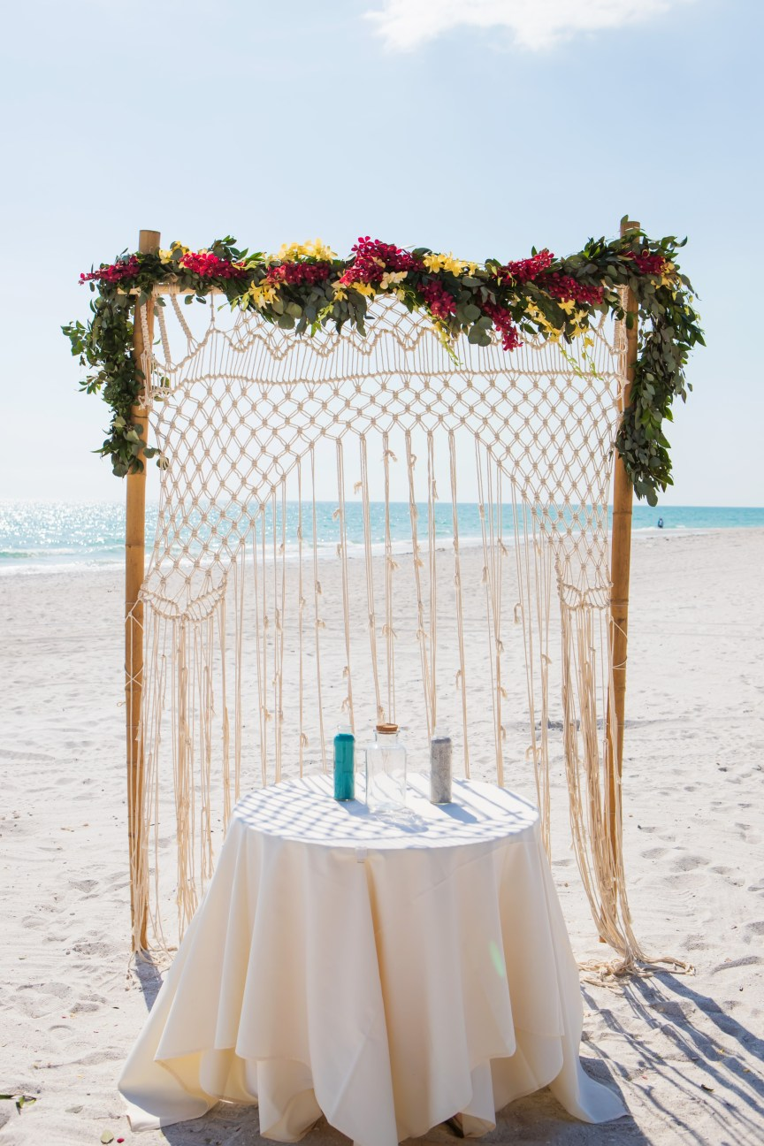 Bamboo Arch with Macrame and Garland of Tropical Leaves and Orchids