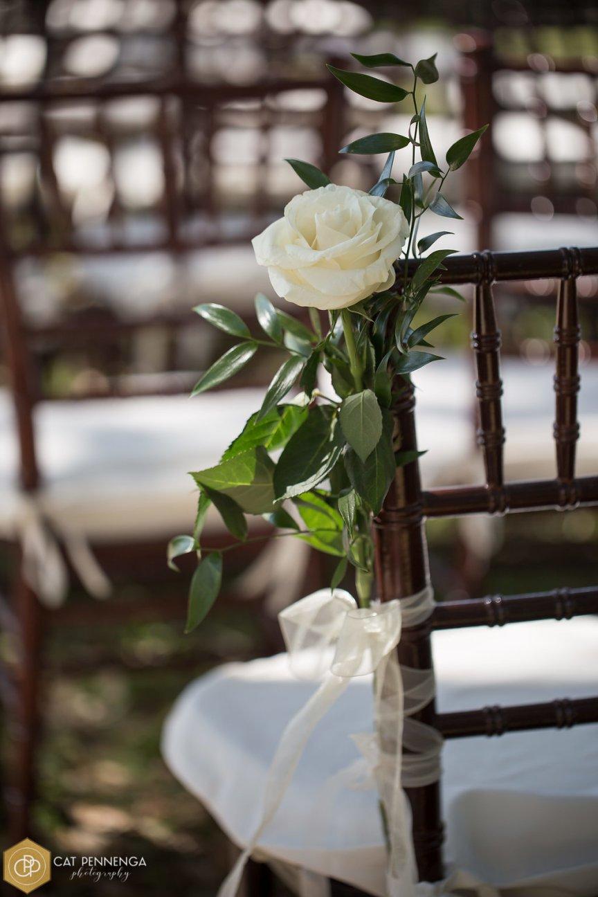 Single Mondial Roses on Chair on Aisle