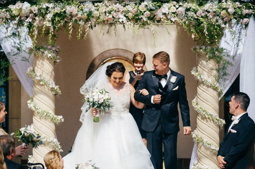 Bride and Groom Under Flowers