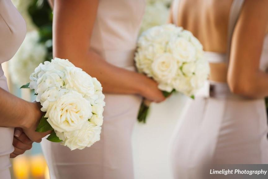 Bridesmaids' with All-White Bouquet