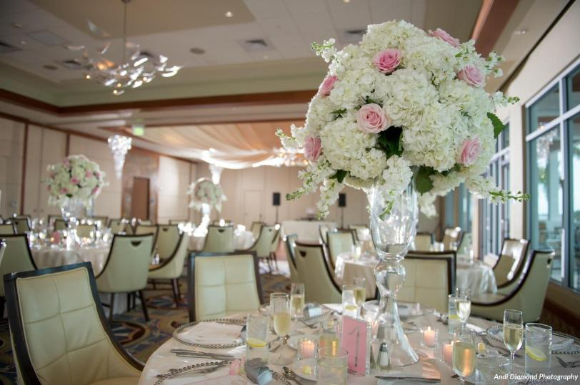 Elevated Guest Table Centerpiece of Pink and White Roses and White Hydrangea
