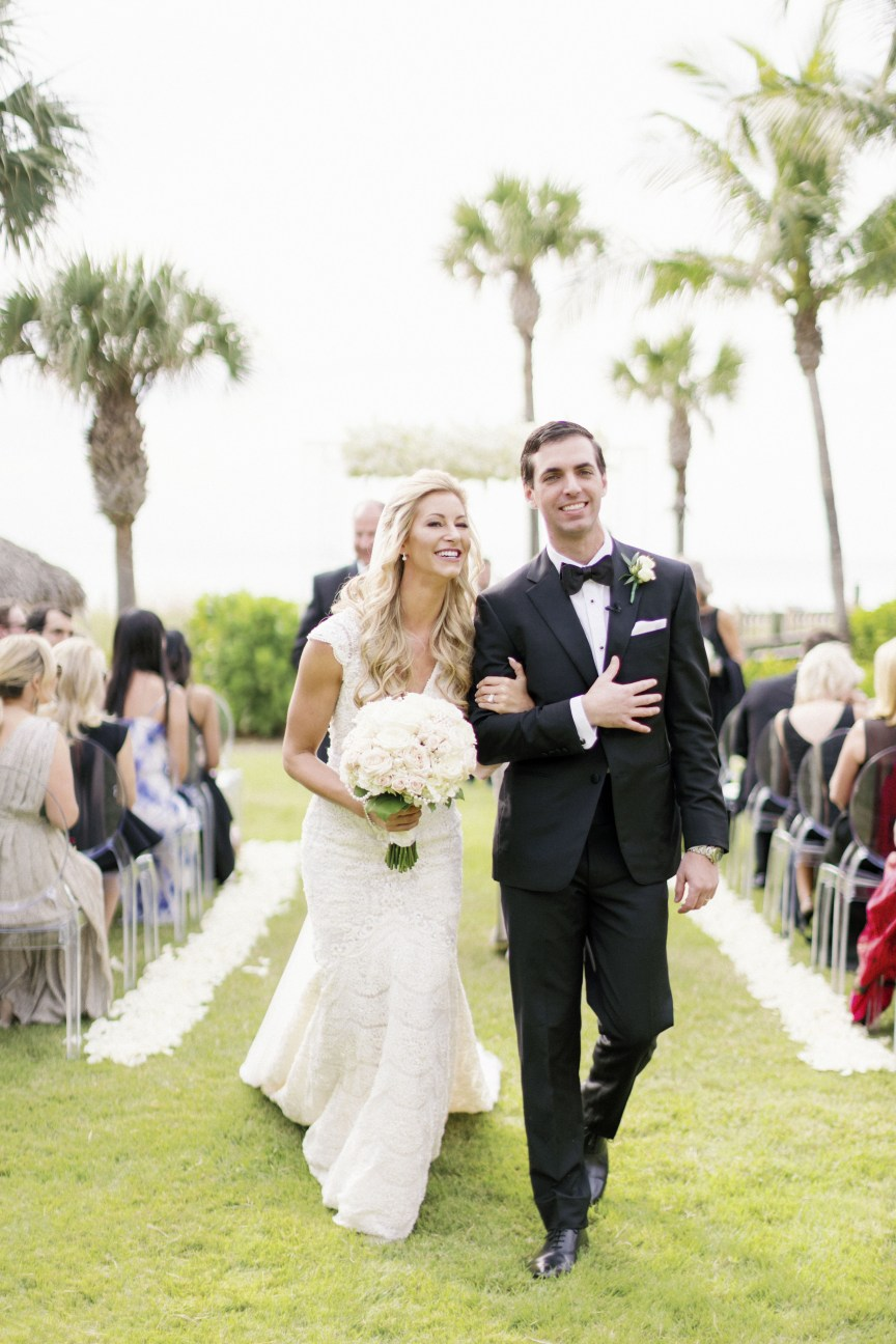Bride with All-White Bouquet and Groom