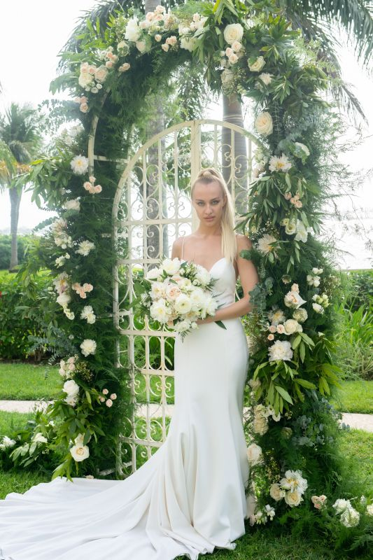 Bride with Garden Bouquet in front of Iron Gate and Arch