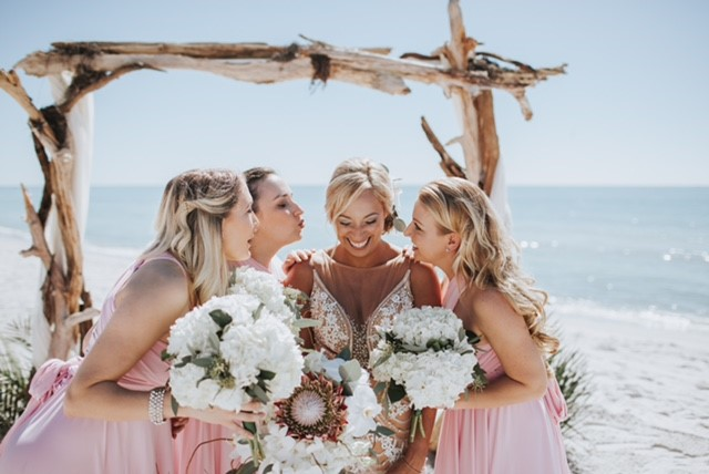 Bride with King Protea Bridal Bouquet and Bridesmaids