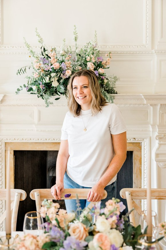 Image of Wedding Planner and Stylist Emma at styled wedding table with information about Weddings by Emma Louise