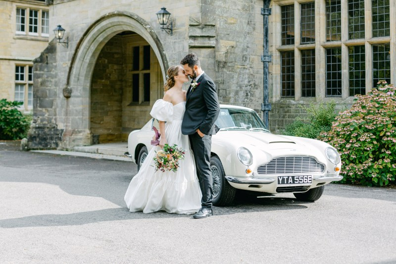 Fine Art bride at UK country house with autumn wedding bouquet.