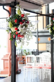 white and coral chuppah flowers