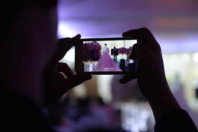 cell phone at wedding ceremony