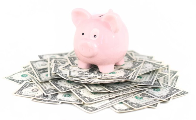 piggy bank with money - manage wedding reception costs