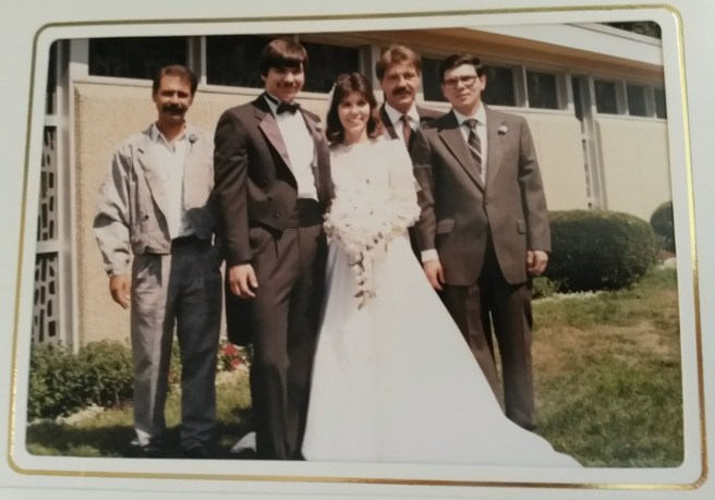 posed photos - picture of me with my brothers on my wedding day