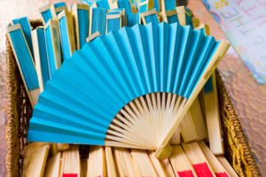 blue fans for guests to use at a wedding ceremony on a hot day