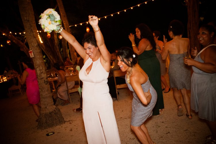 guests dancing at beach reception