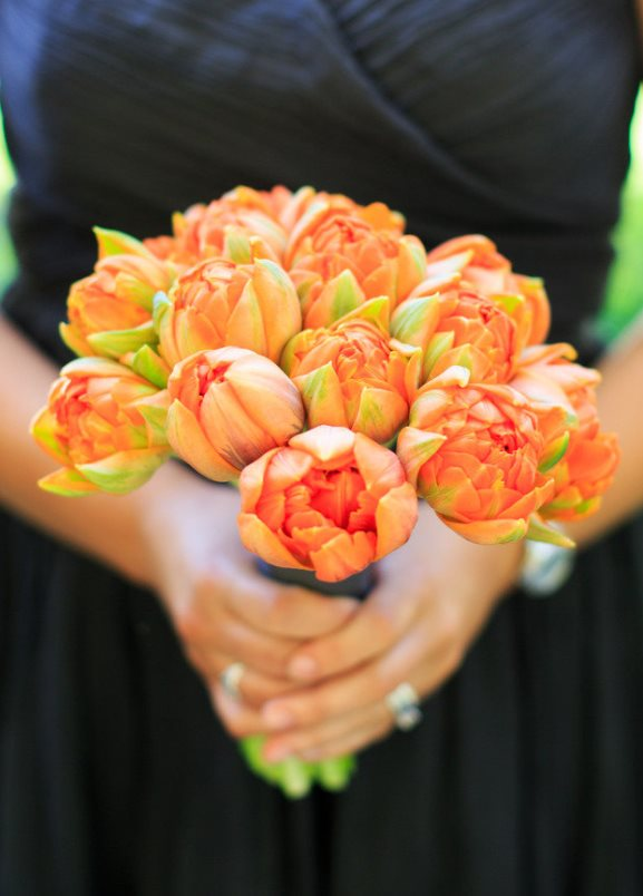 Black Bridesmiads dresses with orange bridesmaids bouquet