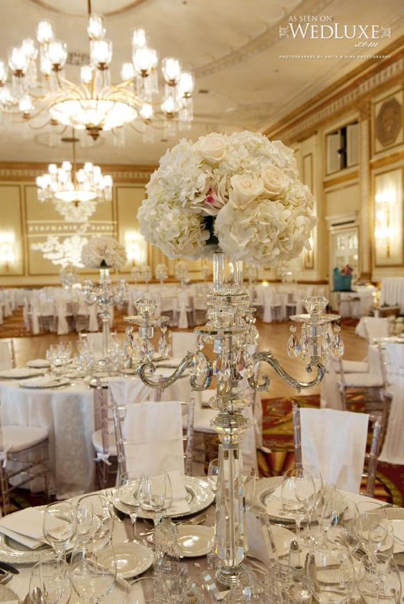 Stylish Silver Candelbra Wedding Centerpiecewith White Flowers