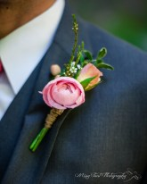 The groom's boutonnière provided by Lucy's Informal Flowers