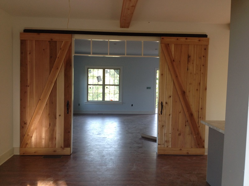 custom room addition with barn doors