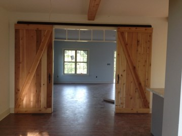 custom room addition with barn doors