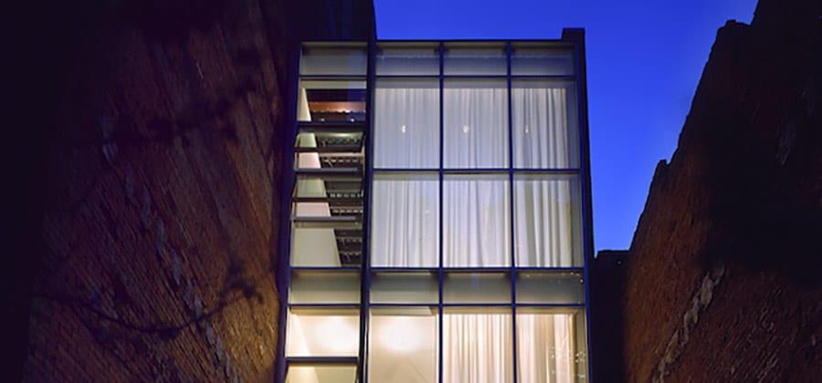 bldg facade from courtyard-night