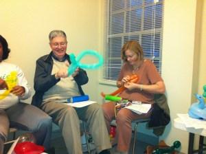 Don & Chris Jolissaint leaders in Child Evangelsim Fellowship work on balloons