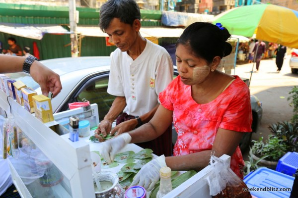 This street cart specializes in making betel quids --  small parcels that typically contain areca nuts wrapped in a betel leaf and coated with lime.