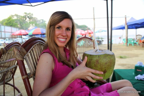 Enjoying a refreshing coconut juice with a beautiful view of U Bein Bridge!