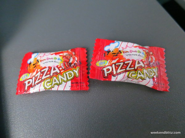"Our in-flight snack: Cola flavored ""Pizza Candy""...wtf?"