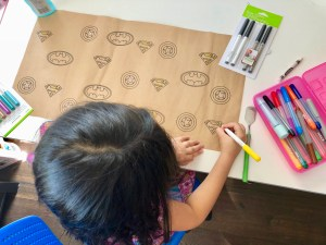 make superhero wrapping paper with Cricut